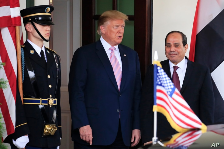 FILE - President Donald Trump welcomes visiting Egyptian President Abdel Fattah el-Sissi to the White House, in Washington, April 9, 2019.