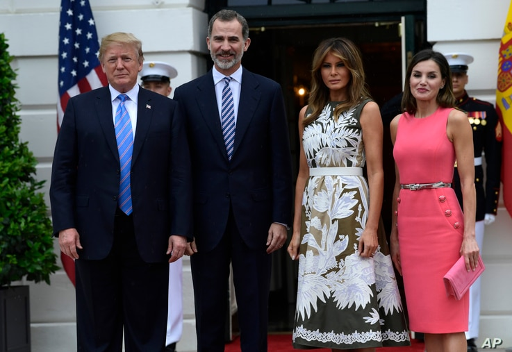FILE - President Donald Trump, left, poses for a photo with Spain's King Felipe VI, second from left, first lady Melania Trump, third from right, and Queen Letizia, right, on the South Lawn of the White House in Washington, June 19, 2018.