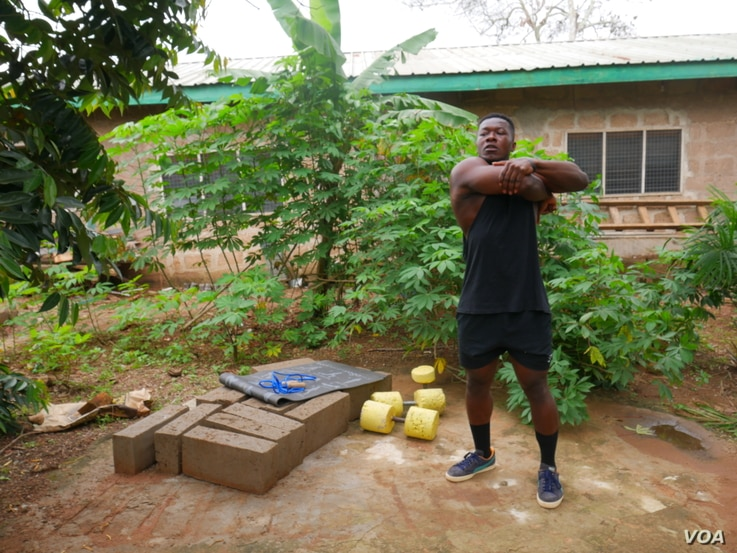 Bodybuilder Samuel Kulbila is living proof that you don't need expensive equipment to work out. People have been reaching out to him for advice on how to keep fit while gyms are closed. Accra, Ghana, July 5, 2020. (Stacey Knott/VOA)
