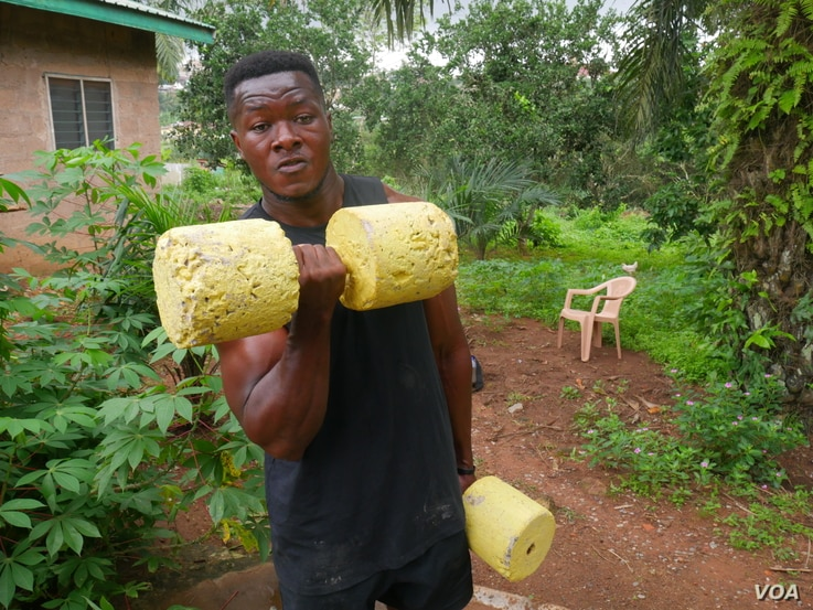 Bodybuilder Samuel Kulbila has gained an international following from posting videos of workouts done with improvised equipment, like concrete weights. Accra, Ghana, July 5, 2020. (Stacey Knott/VOA)