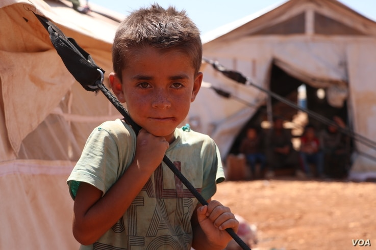 A boy is pictured at a camp in Idlib, Syria, July 24, 2020. A recent U.N. resolution will reduce the flow of humanitarian aid to northwestern Syria, say aid groups.