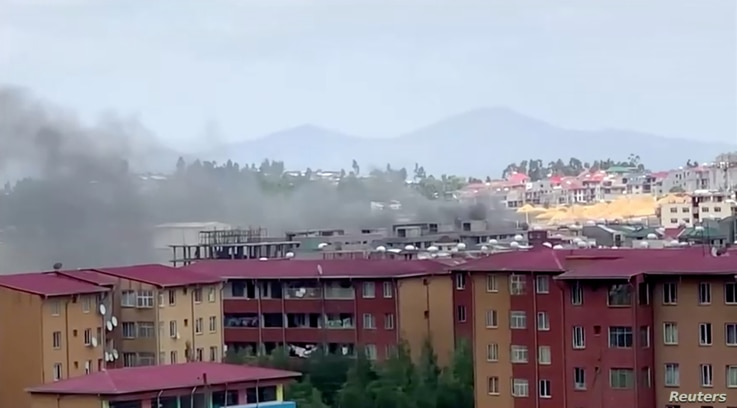 Smoke rises over Addis Ababa skyline during protests following the fatal shooting of the Ethiopian musician Haacaaluu Hundeessaa, June 30, 2020, in this screengrab taken from a video.