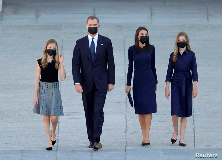 Spain's King Felipe, Queen Letizia, Princess Leonor and Infanta Sofia arrive to a state tribute in memory of Spain's COVID-19 victims at Royal Palace in Madrid.