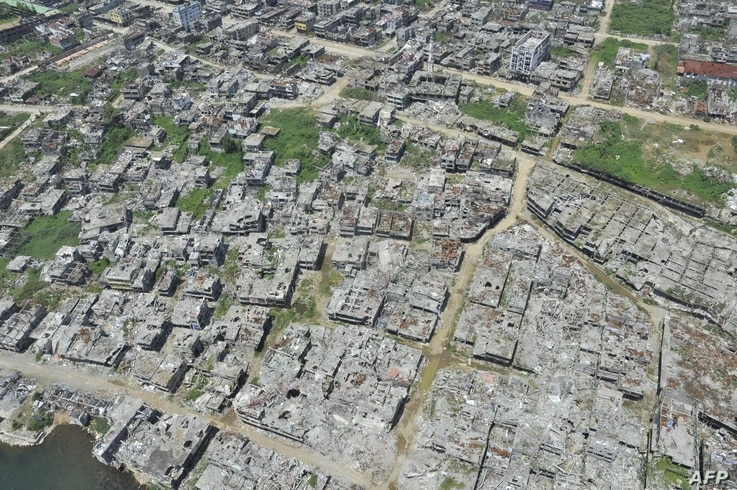 In this photo taken on March 28, 2018 shows an aerial shot of bombed-out houses in Marawi City, in southern island of Mindanao,…