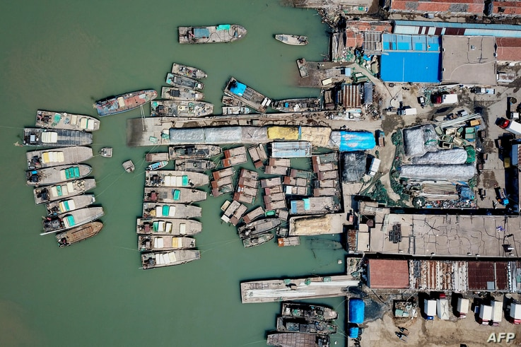 This aerial photo taken on April 27, 2020 shows fishing boats at a port in Lianyungang in China's eastern Jiangsu province, as…