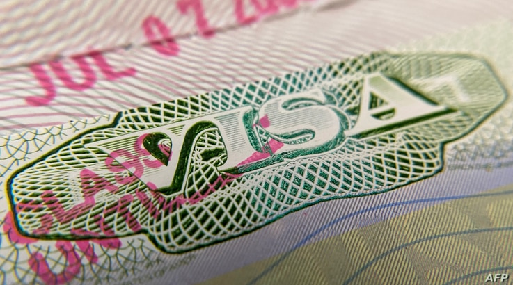 This photo illustration shows a visa stamp on a foreign passport in Los Angeles on June 6, 2020.