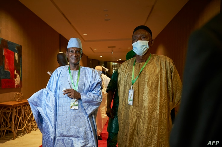 Choguel Maiga (L), a leader of the opposition coalition M5-RFP, arrives at the Sheraton hotel in Bamako on July 23, 2020, where…
