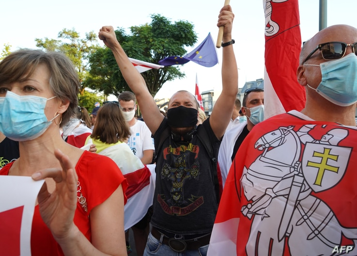 Belarus citizens in Poland demonstrate during a Belarus solidarity demonstration in front of the Belarusian Embassy before…