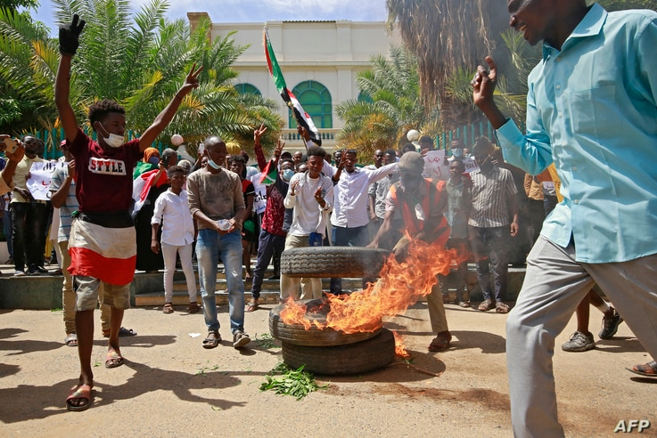 Sudanese protesters shout slogans outside the Council of Ministers in the capital Khartoum on August 17, 2020. - Around 3000…