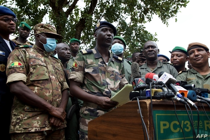 Malian Air Force deputy chief of staff Ismael Wague (front row 2nd L) speaks during a press conference in Kati, Mali on August…