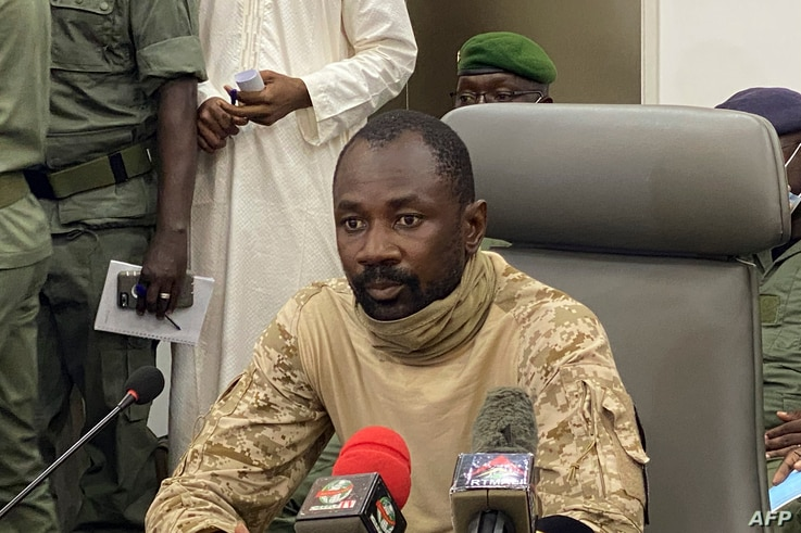 Colonel Assimi Goita speaks to the press at the Malian Ministry of Defence in Bamako, Mali, on August 19, 2020 after confirming…