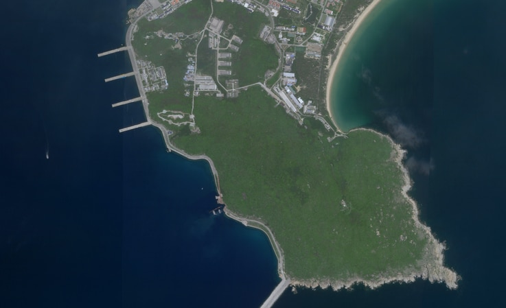 This August 18, 2020, image courtesy of Planet Labs, Inc., reportedly show a Chinese submarine (C, bottom) entering an underground base on Hainan Island on the South China Sea. The satellite image appears to show a Type 093 nuclear-powered attack submarine entering a tunnel on Yulin Naval Base.