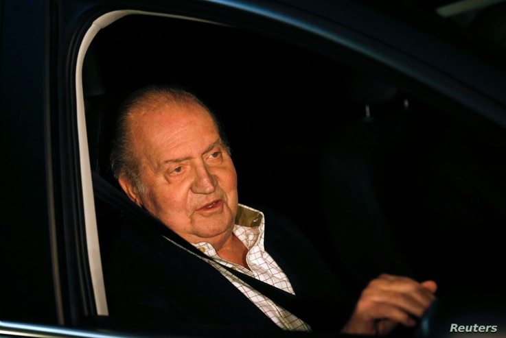 Spain's King Juan Carlos sits in a car after being released from a hospital after a hip operation in Madrid December 2, 2012…