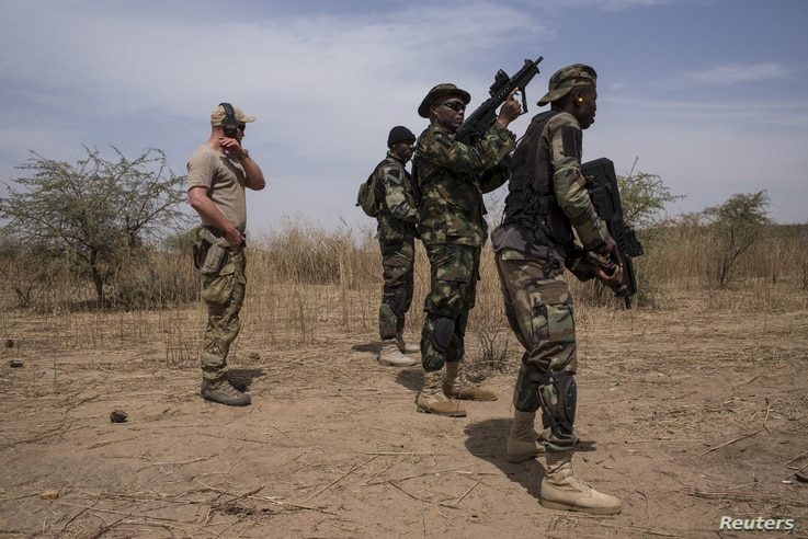A U.S. special forces soldier trains Nigerian soldiers during Flintlock 2016, a U.S.-led international training exercise with…
