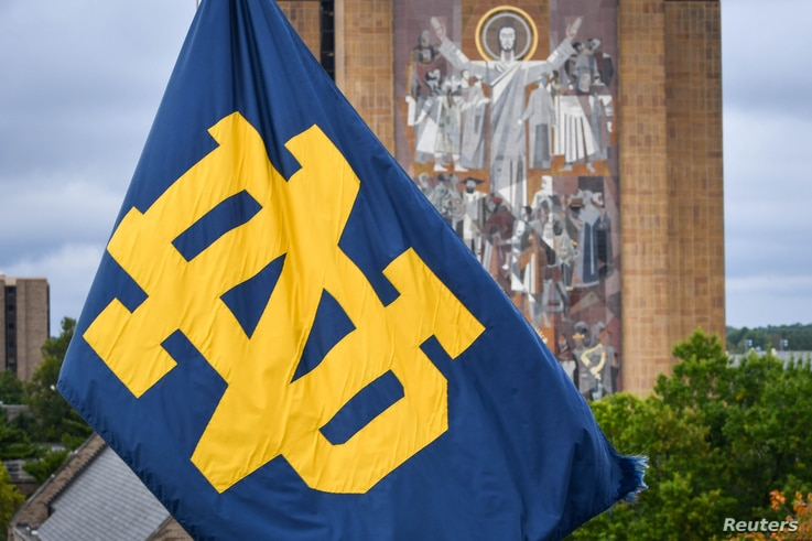 Sep 28, 2019; South Bend, IN, USA; A Notre Dame monogram flag waves in front of the Word of Life mural, commonly known as…