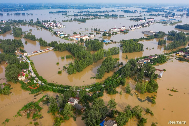 An aerial view shows the flooded Gu town following heavy rainfall in the region, in Luan, Anhui province, China July 20, 2020…