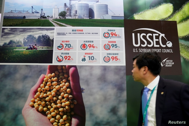 FILE PHOTO: A stall of the U.S. Soybean Export Council is seen during the China International Import Expo (CIIE), at the…