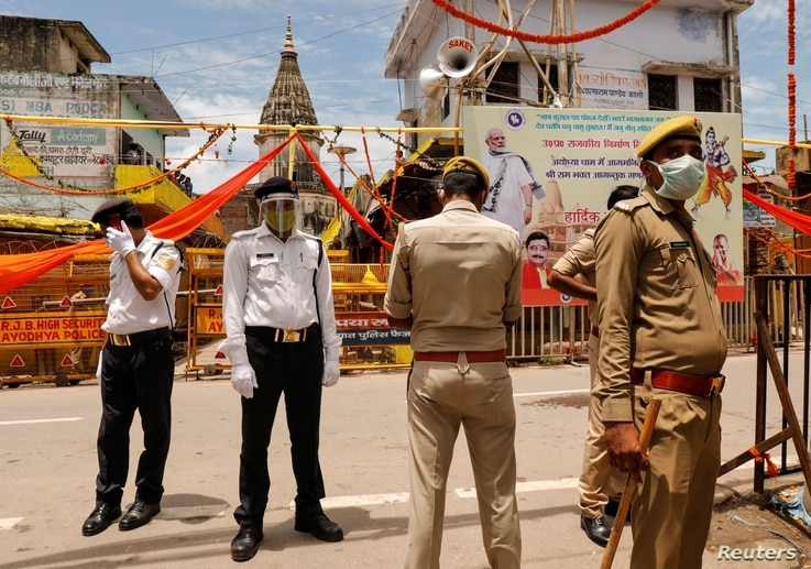 Policemen stand guard before the arrival of India's Prime Minister Narendra Modi ahead of the foundation laying ceremony for a…