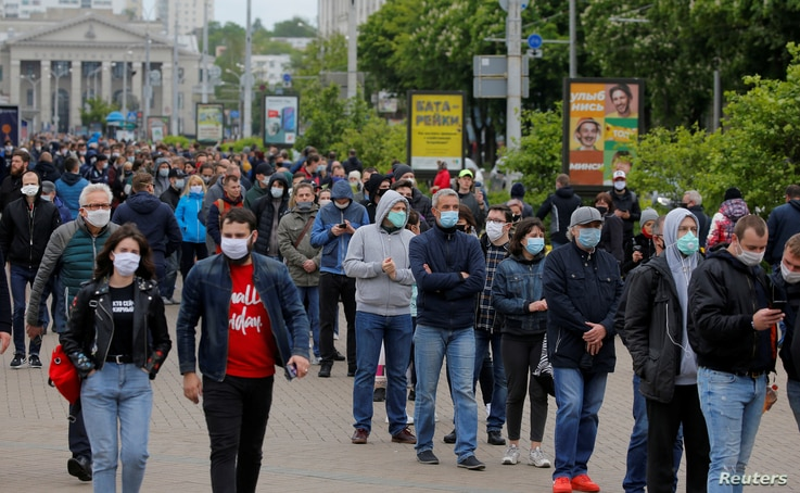FILE PHOTO: Opposition supporters wearing protective face masks amid the coronavirus disease (COVID-19) outbreak wait in a line…