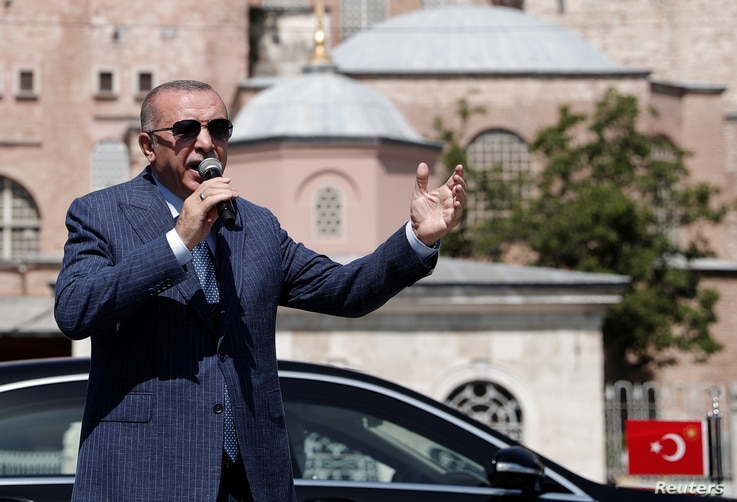 Turkish President Tayyip Erdogan talks to the media after attending Friday prayers at Hagia Sophia Grand Mosque in Istanbul,…