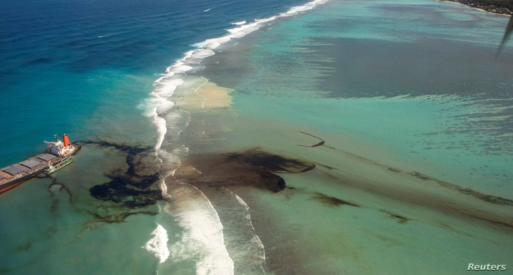 A general view shows the bulk carrier ship MV Wakashio, that ran aground on a reef, at Riviere des Creoles, Mauritius, in this…