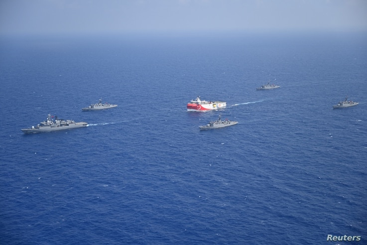 Turkish seismic research vessel Oruc Reis is escorted by Turkish Navy ships as it sets sail in the Mediterranean Sea, off…