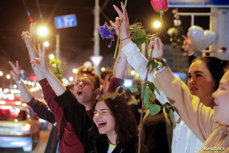People react during an opposition rally to protest against police violence and to reject the presidential election results in…