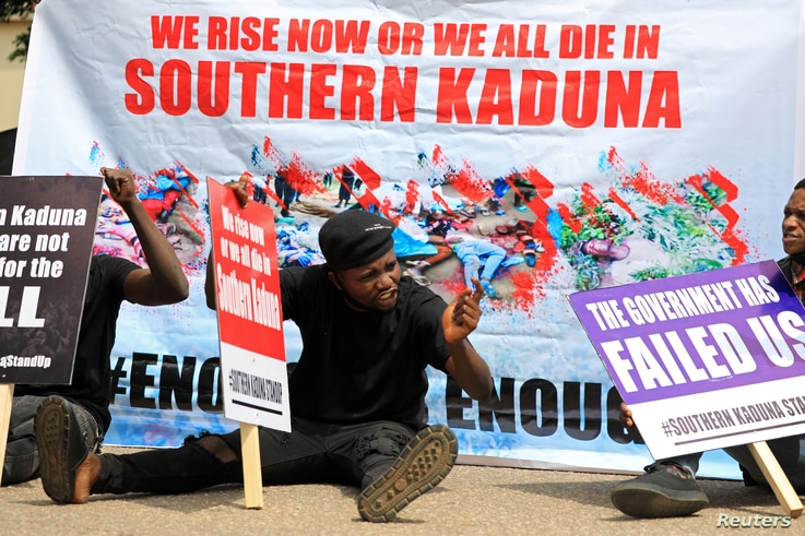 People gather to protest the incessant killings in southern Kaduna and insecurities in Nigeria, at the U.S. embassy in Abuja,…