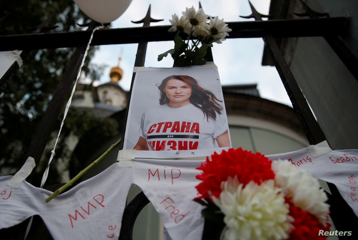 FILE PHOTO: A view shows a photograph of Belarusian opposition leader Sviatlana Tsikhanouskaya, which was attached to a fence…