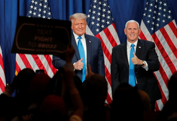 U.S. President Donald Trump and Vice President Mike Pence give thumbs up to the delegates after both addressing the first day…