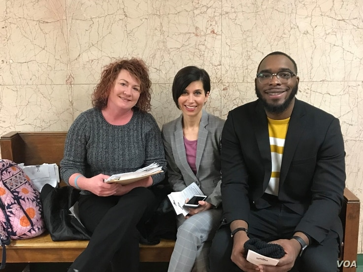 Attorney Gina Chiala (ctr) in court with a tenant (right) and an intern, Kansas City, Missouri.