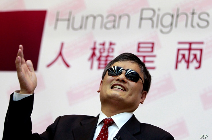 FILE - In this file photo taken Tuesday, June 25, 2013, Chinese activist Chen Guangcheng gestures as he speaks to lawmakers and…