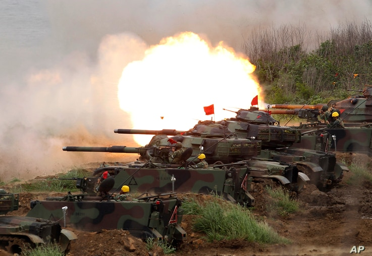 FILE- In this Tuesday, May 25, 2017, file photo, a line of U.S. M60A3 Patton tank fire at targets during the annual Han Kuang…