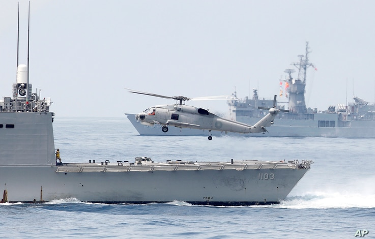 A Taiwan Navy S70 helicopter takes off from the stern of a Perry-class frigate during a navy exercise in the bound of Suao…