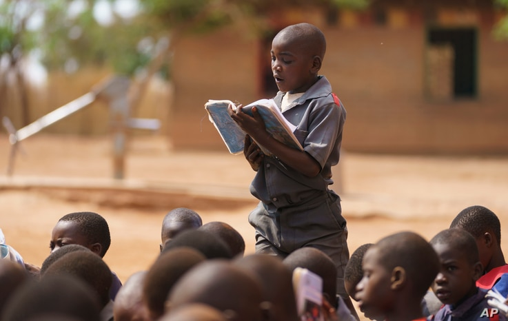 A boy reads aloud during a visit by first lady Melania Trump to Chipala Primary School, in Lilongwe, Malawi, Thursday, Oct. 4,…