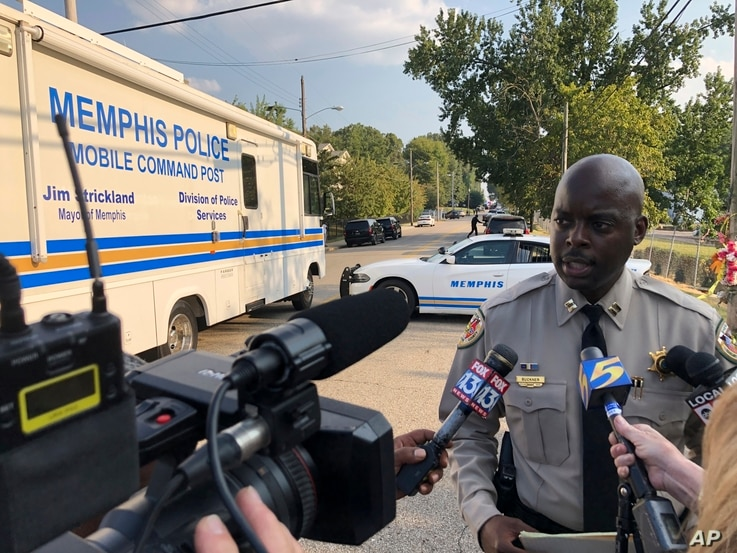 FILE - Shelby County Sheriff's Office spokesman Anthony Buckner talks to reporters about a shooting in which two deputies were injured and a suspect was fatally shot, Sept. 18, 2019, in Memphis, Tenn. Homicides in the city are up nearly 50% in 2020.
