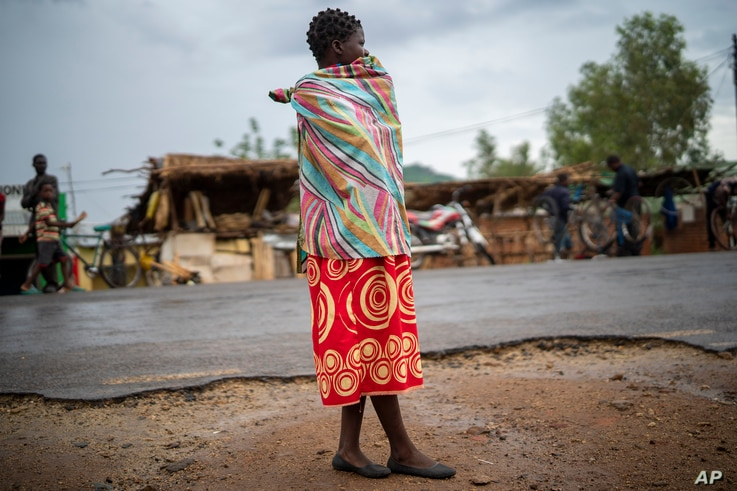 In this photograph taken Tuesday Dec. 10, 2019, A woman stands outside the health clinic in the village of Migowi, Malawi…
