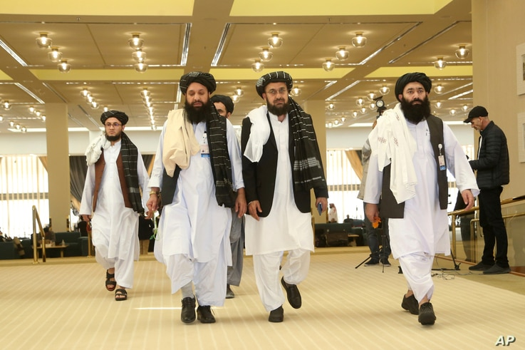 Afghanistan's Taliban delegation arrive for the agreement signing between Taliban and U.S. officials in Doha, Qatar, Saturday,…