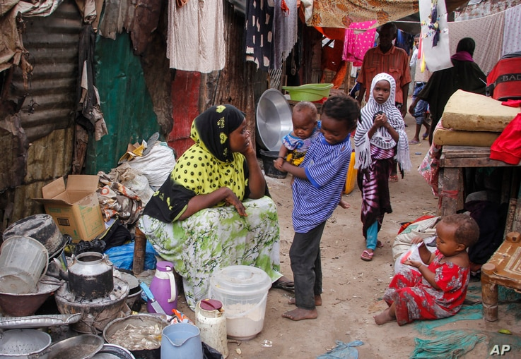 In this photo taken Thursday, March 26, 2020, residents live in crowded conditions in the Sayidka camp for internally displaced…
