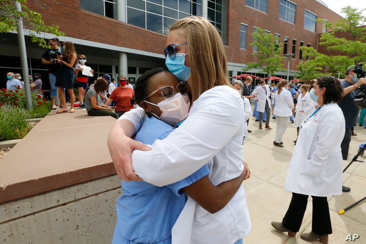 Medical students hug after the 8 minutes 46 seconds of silence in front of the University of Utah Health Sciences Education…
