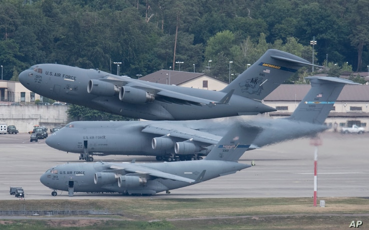 A US military aircraft takes off from the US Airbase Ramstein, Germany, Sunday, June 7, 2020.  According to various media…