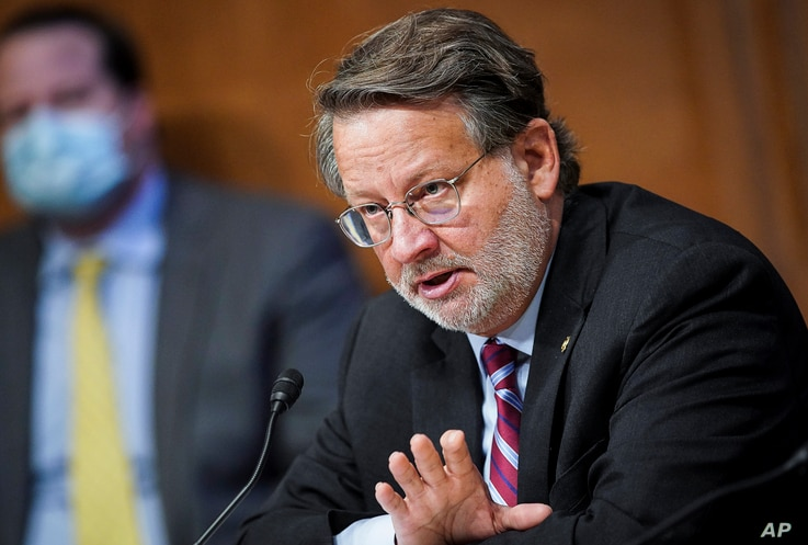 "Sen. Gary Peters, D-Mich., speaks at a Senate Homeland Security and Governmental Affairs Committee hearing titled ""CBP…"