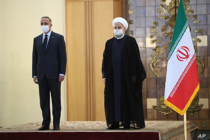 In this photo released by the official website of the office of the Iranian Presidency, President Hassan Rouhani, right,…