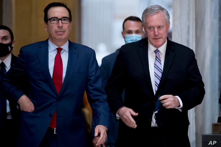 Treasury Secretary Steven Mnuchin, left, and White House Chief of Staff Mark Meadows, right, walk out of a meeting with House…