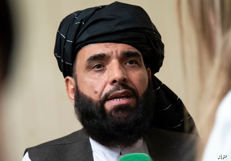 FILE - In this May 28, 2019 file photo, Suhail Shaheen, spokesman for the Taliban's political office in Doha, speaks to the media in Moscow, Russia. The Taliban are warni