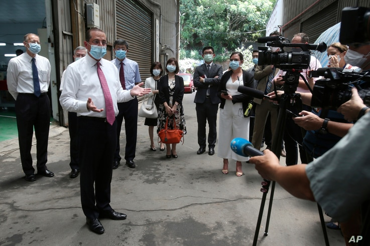 U.S. Health and Human Services Secretary Alex Azar, second from left, answers to the media after visiting a mask factory in New…