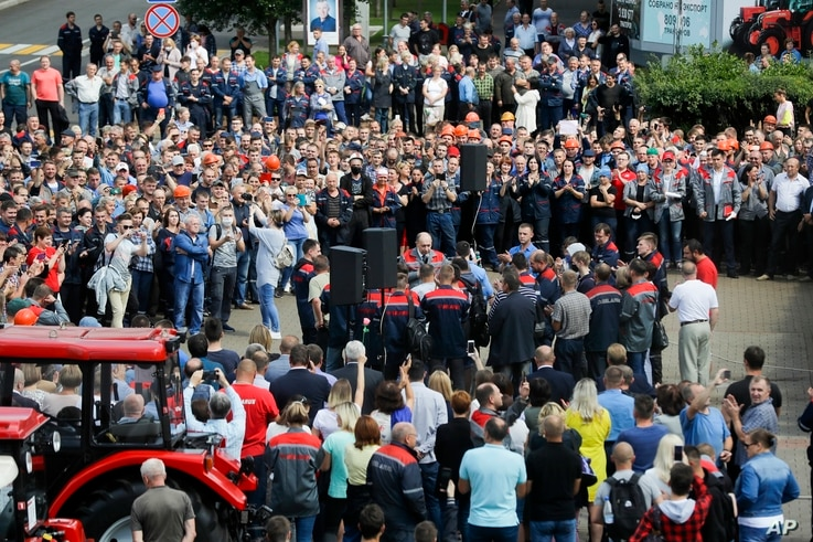 Workers gather during a rally at the Minsk Tractor Works Plant in Minsk, Belarus, Friday, Aug. 14, 2020. Workers at the plant…