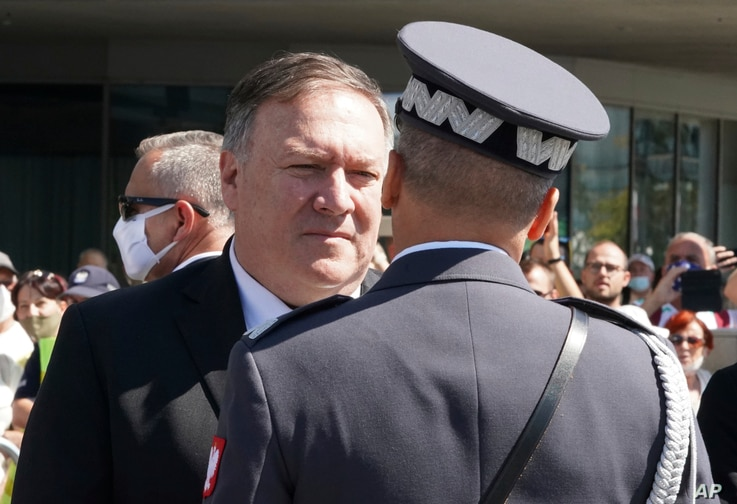 US Secretary of State Mike Pompeo talks to an officer at Pilsudski square in Warsaw, Poland, before ceremonies commemorating…