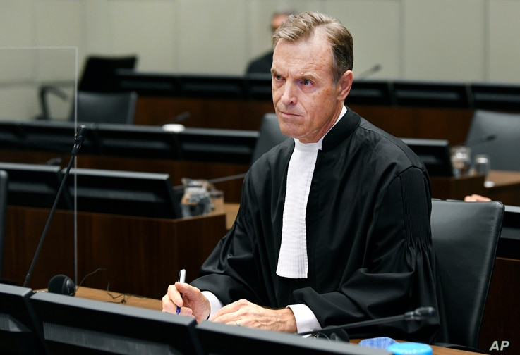 Prosecutor Norman Farrell, attends a session of the United Nations-backed Lebanon Tribunal in Leidschendam, Netherlands, Aug. 18, 2020.