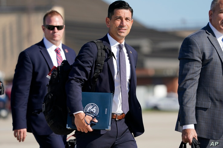 Acting-Secretary of Homeland Security Chad Wolf, center, arrives to join President Donald Trump at Andrews Air Force Base in Md., Tuesday, Aug. 18, 2020. Trump will speak at a campaign rally in Yuma, Ariz. (AP Photo/J. Scott Applewhite)